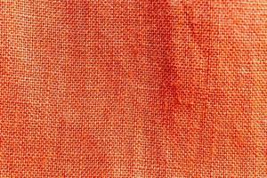 orangefarbener Leinenstoff Textur Hintergrund foto
