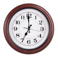 genau sieben Uhr auf einer runden Uhr foto