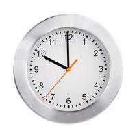 genau zehn Uhr auf einer runden Uhr foto