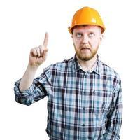 Mann mit Helm zeigt seinen Zeigefinger nach oben foto