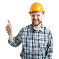 Mann mit Helm zeigt den Zeigefinger nach oben foto