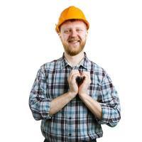 Mann in einem Helm, der Hände Herz zeigt foto