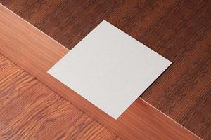 weißes quadratisches Papiervisitenkartenmodell auf braunem Holztischhintergrund. Branding Präsentationsvorlage Druckgrafikdesign. ein Kartenmodell. 3D-Darstellung Rendering foto