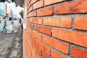 alter Backsteinmauerhintergrund aus Ziegelsteinen Wandoberflächenstruktur foto