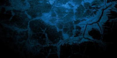 gruselige dunkelblaue rissige Wand für den Hintergrund foto