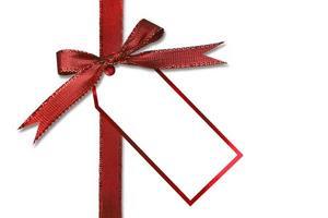 Weihnachtsgeschenkanhänger und Schleife foto