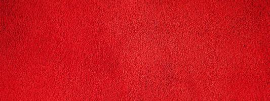 rote Wildlederstruktur. Makrofoto einer roten Samtbeschaffenheit. foto