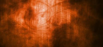 orange Wand mit dunklen Schatten. dunkelorangefarbener Zement für den Hintergrund foto