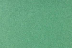 grüne Offset gedruckte Papierhintergrundtextur. Makro hautnah. Vollbild foto