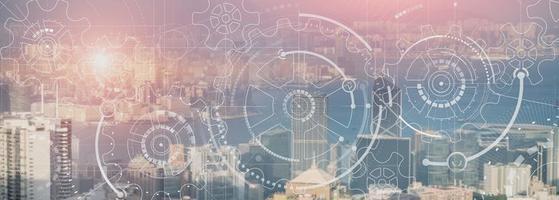 Business-Technologie-Konzept. Zahnradgetriebemechanismus mit moderner Stadtansicht. Website-Panorama-Header-Hintergrund. foto