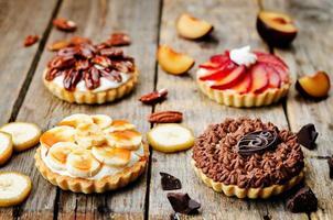 Banane gesalzen Karamell Schokolade Pflaumen Honig Pekannuss Törtchen