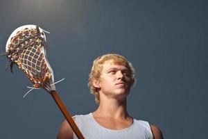 Lacrosse-Spieler mit Lacrosse-Schläger foto