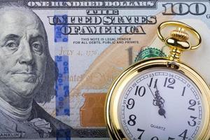 100 Dollar, Zeit ist Geld foto