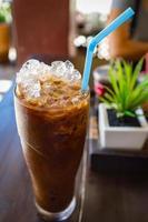 Eiskaffee mit Milch auf Topping Getränk foto