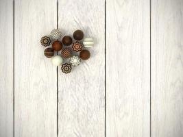 Praline Ostereier Herz auf weißem Holzboden - Draufsicht foto