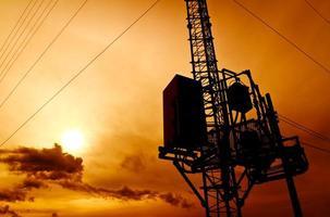 Silhouette Telekommunikationsmast foto