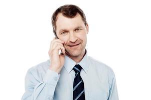 männliche Führungskraft mit ist Handy foto
