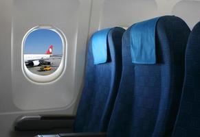 Flugzeugsitz und Fenster foto