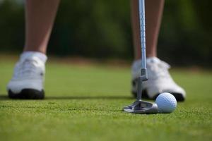 Golfspieler tippen ein foto