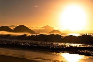 Sonnenaufgang in Copacabana Strand