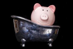 schmutziges Geld Sparschwein foto