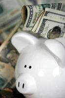 Sparschwein mit Geld foto