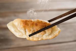 Chinesische Mahlzeit Pfanne gebratene Knödel foto