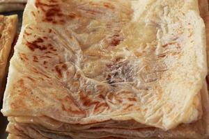 Chapati auf dem Tisch kochen foto