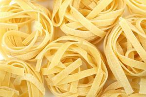 Tagliatelle Nest Pasta Hintergrund foto