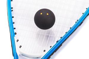 Squashschläger und Bälle foto