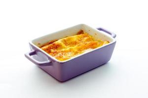 Cannelloni mit Schinken und Käse gebacken foto