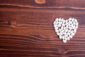 rohe weiße Bohnen auf dem Brett diätetische Nahrung foto