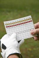 Golfspieler und Scorekarte foto