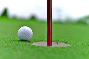 Golf auf Loch foto