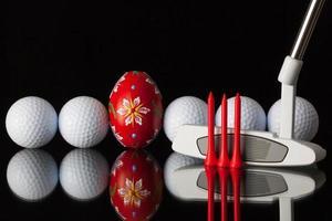 Golfausrüstung und Ei foto