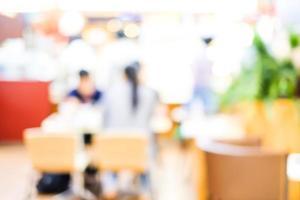 verwischen Café mit Menschen und Bokeh hellen Hintergrund foto