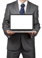 Geschäftsmann hält Laptop foto