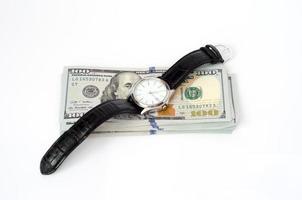 Uhr auf dem Dollar foto