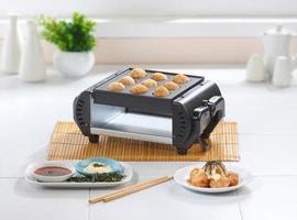 Takoyaki japanische Lebensmittelmaschine foto