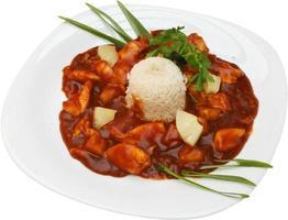 chinesisches Huhn mit Tomate und Reis
