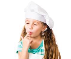 Mädchen in Kochmütze foto