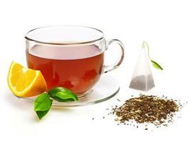 Tasse Tee mit Zitrone foto