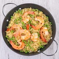 Reis, Erbsen und Garnelen foto