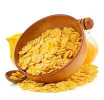 Cornflakes in Schüssel auf Weiß foto