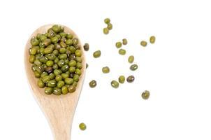 grüne Bohnen und Holzlöffel foto