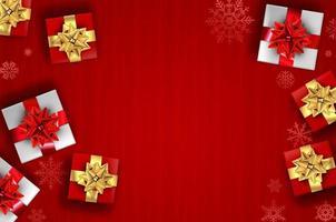 roter Weihnachtshintergrund - Geschenke und Schneeflocken foto