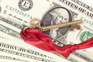 Schlüssel zum Erfolg auf Ein-Dollar-Banknoten foto