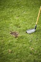 Golf Divot auf dem Fairway foto