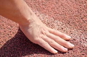 Hände auf der Startlinie foto