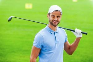 selbstbewusster Golfer. foto